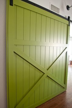 DIY barn door tutorial: Barn doors are popping up in homes everywhere and you can make one for a fraction of the cost of buying one