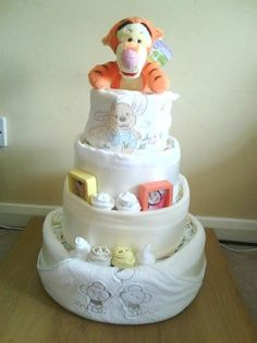 A tigger surprise - Nappy cake filled with tigger and winnie the pooh clothing by Lolobelle Baby Shower Nappy Cake, Baby Shower Diapers, Baby Shower Gifts, Baby Boy Cakes, Cakes For Boys, Pamper Cake, Cake Competition, Vintage Pram, Towel Cakes