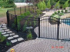 Aluminum pool fencing, love the landscaping in the pool area, bushes and small trees