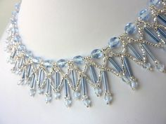 DIY Jewelry: Free beading pattern for lovely ice blue crystal necklace, resembling frozen icicles, made with round crystals, bugle beads, and seed beads.