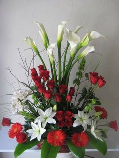 I made this arrangement for a funeral May 4,2014.  It was fairly easy to make & turned out beautiful...was close to the picture.