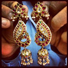 Elegant classy Ruby Polki gold jhumka earrings. @Umrao Jewels