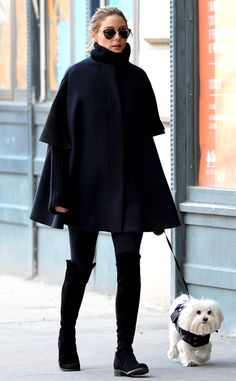 Olivia Palermo from Celebs in Coats Olivia again reminds us why she's the queen of street style wearing this drool-worthy black caped coat and over-the-knee boots.