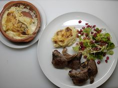 gratin Dauphinois, lamb and a salad with pomegranate