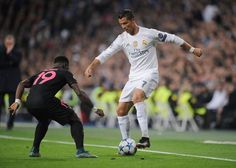Serge Aurier of Paris St.Germain confronts Real Madrid's Cristiano Ronaldo in the Champions League match in Madrid, which Real won 1-0