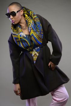Stunning ankara print oversized play collar coat. This coat is very warm, elegant and very versatile. Ive used a beautiful brown wool to compliment this fantastic Vlisco print collar that can be used to create various shapes as seen in the pictures.  Coat comes with side pockets and is beautifully lined.  If you are looking for a unique, statement coat this is the one for you.  Timeless.  One size fits all - UK 10 - 20 (US 6 - 16)