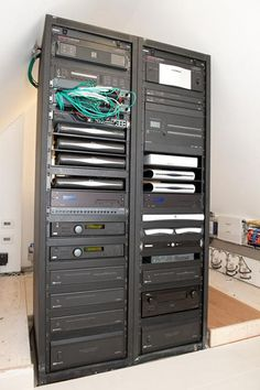 Equipment rack neatly conceals home automation system electronics home automation systems do it yourself smarthomeautomation solutioingenieria Choice Image