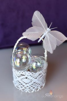 Lace favor basket with iridescent bubbles and iridescent feather butterflies. Floating Candle Centerpieces, Wedding Centerpieces, Wedding Favors, Party Favors, Butterfly Wedding Theme, Tabletop Accessories, Iridescent, Butterflies, Bubbles
