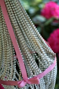 Spraypaint and patience can turn beads into a chandelier. | 31 Cheap And Brilliant Dollar Store Hacks