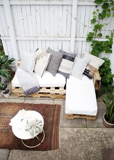 Cozy outdoor furniture for enjoying the lazy days of summer is a must-have for me! One of my favorite things we've ever made is this Pallet Swing Bed a few years ago! For those that might not have a t