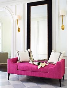 Gold sconces & hot pink daybed, love love