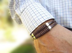 Free Shipping. Men's Leather and Weaved Cord Bracelet: Genuine Chocolate Brown Leather, Silver Sliders with Magnetic Clasp.
