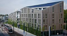 Stadthaus M1 housing and Green City Hotel, Freiburg, Germany, by Barkow Leibinger