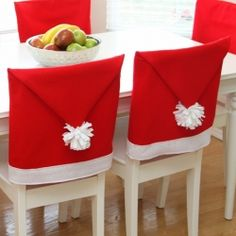 Chase away any bah-humbug moods with these whimsical Santa Hat Chair Covers.