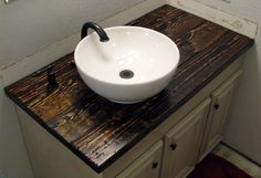 Bathroom vanity...and I love this wooden countertop!