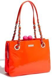 orange and pink Kate Spade handbag