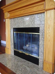 Fireplace Before  Paint out your brass fireplace parts those ugly doors Cheap temporary fix