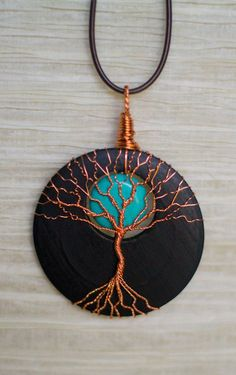 Tree of Life pendant Copper Wire Wrapped Wood Slice with Turquoise Moon Accent by RecycledBeautifully on Etsy Wire Wrapped Jewelry, Wire Jewelry, Beaded Jewelry, Handmade Jewelry, Tree Of Life Jewelry, Tree Of Life Pendant, Wire Crafts, Jewelry Crafts, Bijoux Fil Aluminium