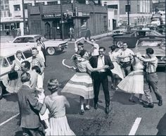 The mood was very happy in the People were worried about being happy, not about saving money. People bought expensive things and lived pretty comfortable lives. These people dancing on the street illustrates the mood of the perfectly. Lindy Hop, Shall We Dance, Lets Dance, Street Dance, Dance Photography, Vintage Photography, 1950s Dance, Rockabilly, Rock And Roll