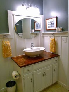 A butcher block top turns this vanity high end. From Unbelievable Budget Bathrooms