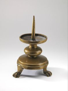 candlestick 1275-1300 Dimensions h. 18.5 x w. 11.5 cm Material and technique brass