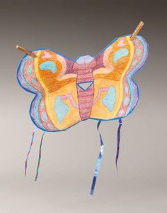 Brighten your backyard for a colorful picnic with this butterfly kite craft!