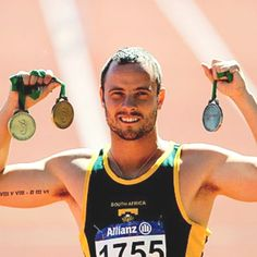 Call me crazy, but I think bicep tattoos are the sexiest place for a guy to have a tattoo, and Oscar Pistorius definitely pulls it off.