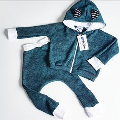 TEAL TRACKSUIT Pairing our Zip Hoodie with matching Harems, these athleisure inspired Tracksuits are extremely versatile and great for layering. Zip Hoodie, Athleisure, Ears, Rompers, Hoodies, Clothes, Collection, Dresses, Fashion