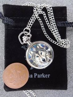 This is a stunning silver plated pocket watch featuring the artwork of Lisa Parker The real working pocket watch comes with a detachable clip so you