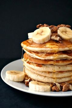 Fluffy American pancakes with walnuts and bananas, and a good squeeze of honey, an indulgent, yet healthy breakfast to have a great start of your day.