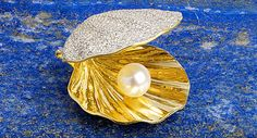 An 18ct gold diamond and cultured pearl oyster shell