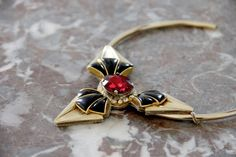 A series of gold-plated brass chockers, assembled with vintage brooches, Swarovski crystals, and embroidery.