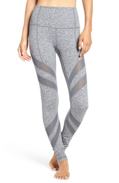 Mesh insets curve around the legs in these figure-sculpting leggings with a high, slip-free waistband.