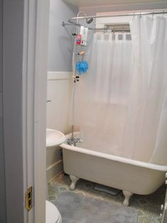 Solution for a shower with a window- oval rod with exterior connected shower head. Simple curtain over window, could be made out of indoor/outdoor fabric.