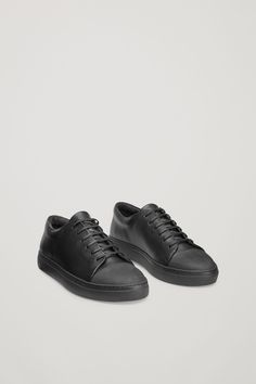 ebe99ac69e2c COS — Leather sneakers with rubber toe caps in Black Black Sneakers