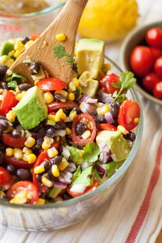 Corn, Avocado & Black Bean Salad  Ingredients   Veggies: •1 3/4 cup thawed frozen or fresh sweet corn •40 cherry tomatoes, halved •1 15 oz. can of black beans, rinsed and drained •2 avocados, diced •1 red onion, finely diced •1/4 cup cilantro, chopped (use the stems too!)  Dressing: •2 Tbsp. olive oil •1 lemon, juiced (or 2 limes) •1-2 tsp. cumin •1/2 tsp. kosher salt •1/2 tsp. ground black pepper
