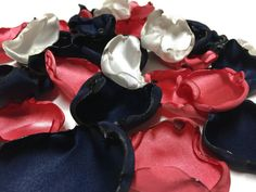 A personal favorite from my Etsy shop https://www.etsy.com/listing/272083294/navy-blue-coral-and-ivory-flower-petals