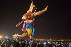 Lord Ganesh marches to the sea for visarjan at Girgaum chowpatty in Mumbai, India