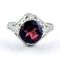 Garnet is my birth stone. Love the Art Deco feel of this ring.