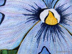 French Pansy (detail) - shows machine thread sketching on a small quilt featuring a blue pansy.