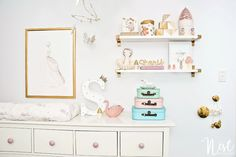 Beautifully styled changer and shelving in this stylish pink and gold nursery.