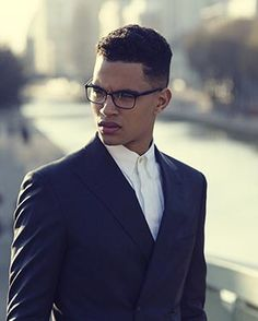 Somewhere in between a soft taper and a skin fade - achievable with Afro hair