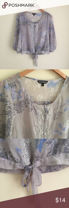 """Express sheer gray floral blouse sz S Express sheer printed gauze blouse, size S.   Pale gray with floral print, lace accent placket, tie at waistband, blouson 3/4 length sleeves.  Very sheer and needs to be worn over another top.   Condition:  very good pre-loved.   Flaw: small hole in lace near waistband, not noticeable when worn, see photo 6.   Material:  100% polyester.   Measurements (approximate, taken flat): length 21"""", pit-to-pit 19.5"""", flat waist 18"""", sleeve 18"""". Express Tops…"""