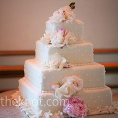 Polka-dots and fresh flowers decorated the white cake 
