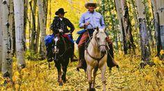 7 Incredible Horseback Riding Trips in Colorado - Horseback riding through Colorado's golden aspen leaves – near Idaho Springs, Colorado
