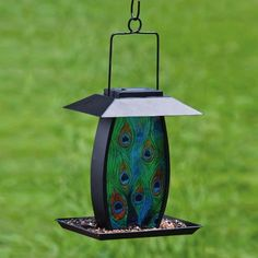 Evergreen Garden,Metal and Glass,Solar Bird Feeder,Peacock Grandeur,8.5x7x10 Inches by Gifted Living, http://www.amazon.com/dp/B0094KIHHA/ref=cm_sw_r_pi_dp_KIFGrb1DT6SCQ