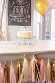 pink and gold party streamer garland. Roll tissue paper, cut and fold over string. the streamer with silver. white and light pink