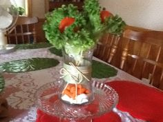 A vegetable flower gift for the sick.  Cherry tomatoes on wooden skewers, wrapped with leafy lettuce, and baby carrots in the bottom of the vase. Viola!