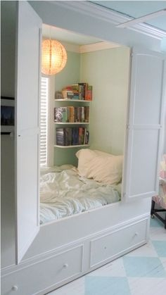 How cool is this?  Basic frame with doors creates bed cubby.  Great idea for studio apartments or rooms where two kids share and maybe have different bed times.  You could block light and some sound from the one already sleeping. Wish I had this as a kid