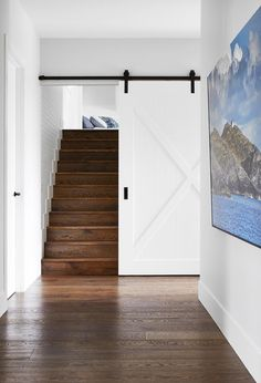 A functional yet luxurious home on the Mornington Peninsula At the end of this hallway, a white barn door opens up to a timber staircase. Timber Staircase, Staircase Design, Mcm House, White Barn, Bedroom With Ensuite, Australian Homes, Interior Barn Doors, Luxury Homes, Building A House